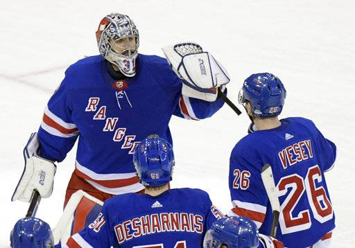 New York Rangers goalie Ondrej Pavelec (31) celebrates with left wing Jimmy  Vesey ( 65b2b7711