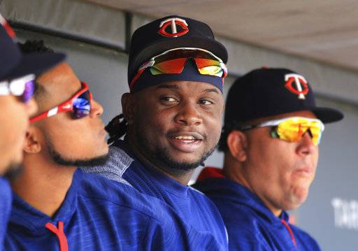 File-This Aug. 6, 2017, file photo shows Minnesota Twins third baseman Miguel Sano sitting in the dugout against the Texas Rangers in the sixth inning during a baseball game on  in Minneapolis.  A photographer is accusing  Sano of grabbing her wrist and trying to kiss her and pull her through a door after a 2015 autograph session. Betsy Bissen accused Sano on Thursday, Dec. 28, 2017, in a tweet, saying what he did amounted to assault.
