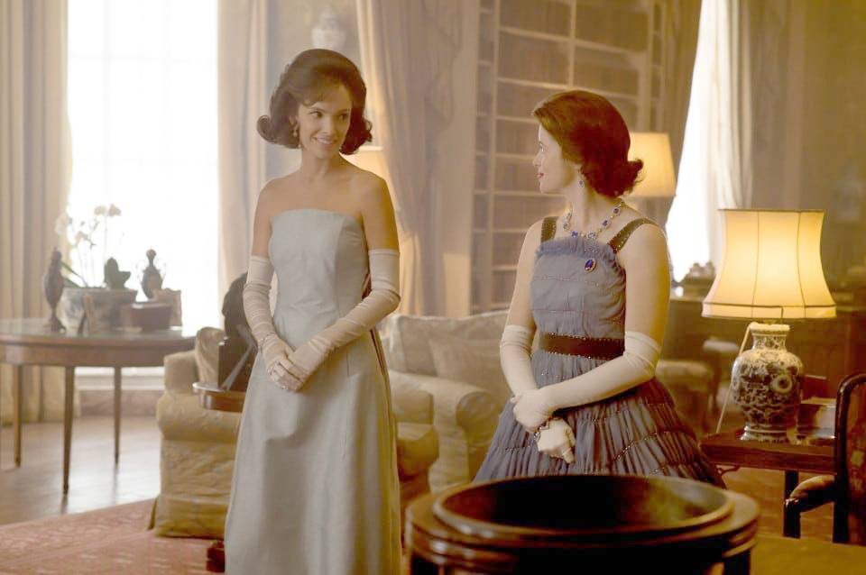 "Jackie Kennedy (Jodi Balfour) and Queen Elizabeth II (Claire Foy) interact in Season 2 of Netflix's ""The Crown."""