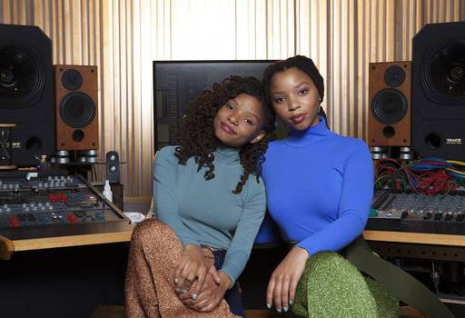 "In this Dec. 22, 2017 photo, Halle Bailey, left, and Chloe Bailey of ""Chloe x Halle"" pose for a portrait at RMC Studio in Los Angeles. (Photo by Rebecca Cabage/Invision/AP)"