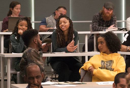 "This image released by Freeform shows Halle Bailey, from left, Trevor Jackson, Chloe Bailey and Yara Shahidi in an episode of, ""grown-ish,"" a spin-off from the ABC comedy ""black-ish,"" airing Wednesday, Jan. 3 on Freeform. (Kelsey McNeal/Freeform via AP)"