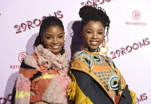 "FILE - In this Dec. 6, 2017 file photo, Halle Bailey, left, and Chloe Bailey, of Chloe x Halle, appear at the West Coast debut of 29rooms  in Los Angeles. The sisters will appear in ""grown-ish,"" a spin-off from the ABC comedy ""black-ish,"" airing Wednesday, Jan. 3 on Freeform. (Photo by Jordan Strauss/Invision/AP, File)"