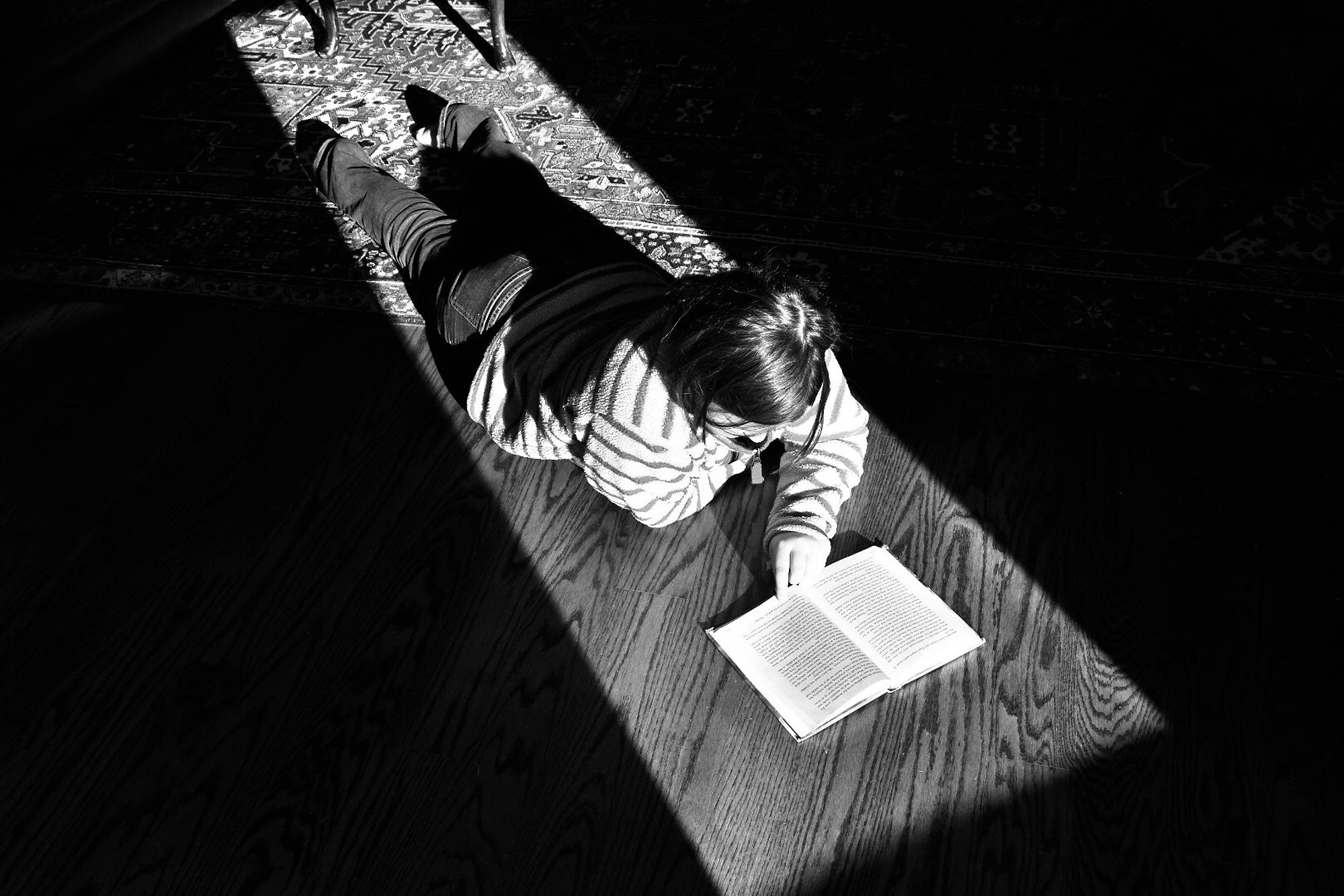 This is my sister, reading in the winter sun's light streaming through the window.