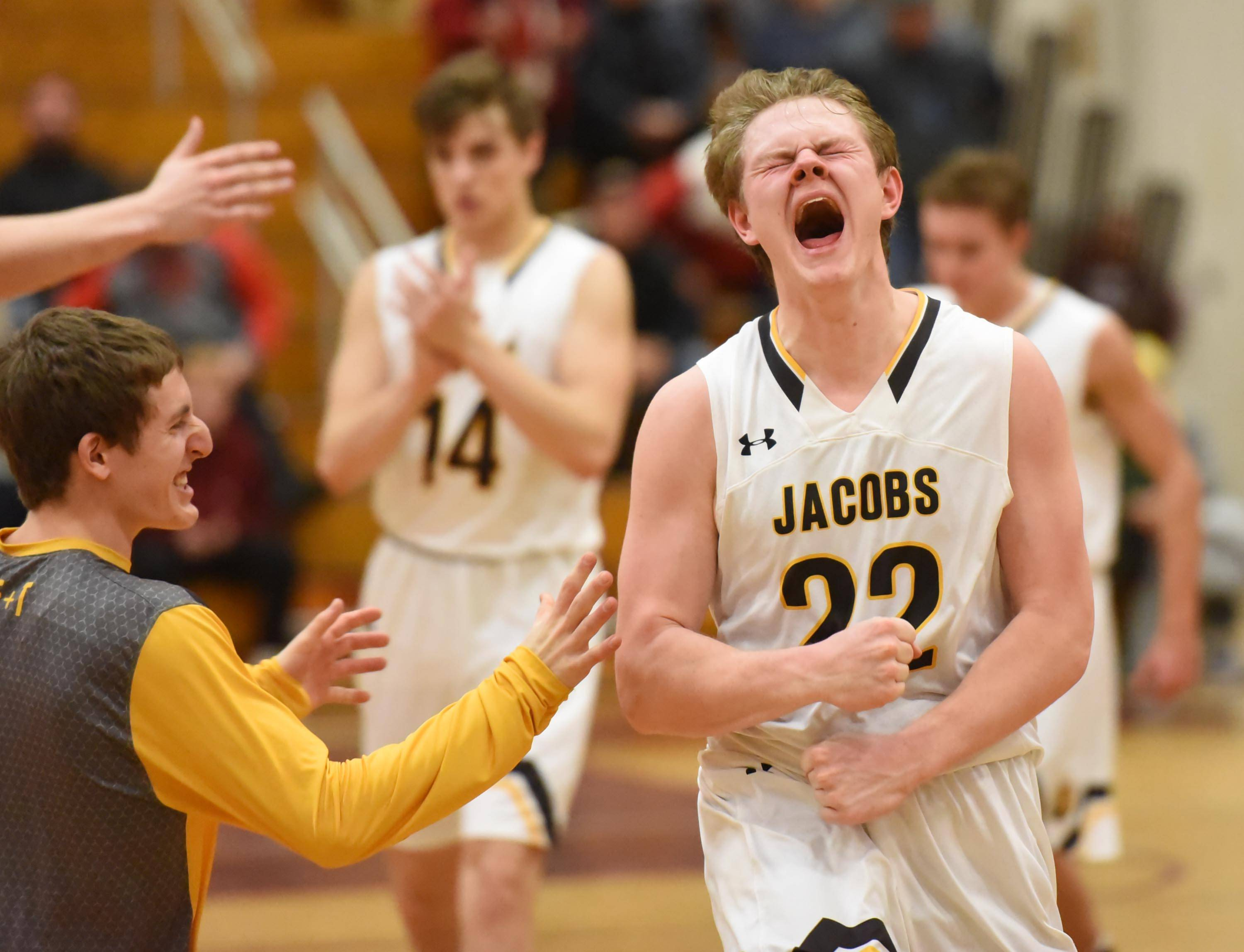 Jacobs' Mason Materna reacts as time expires on the Golden Eagles' win against Hononegah in the Class 4A Elgin sectional semifinal game.