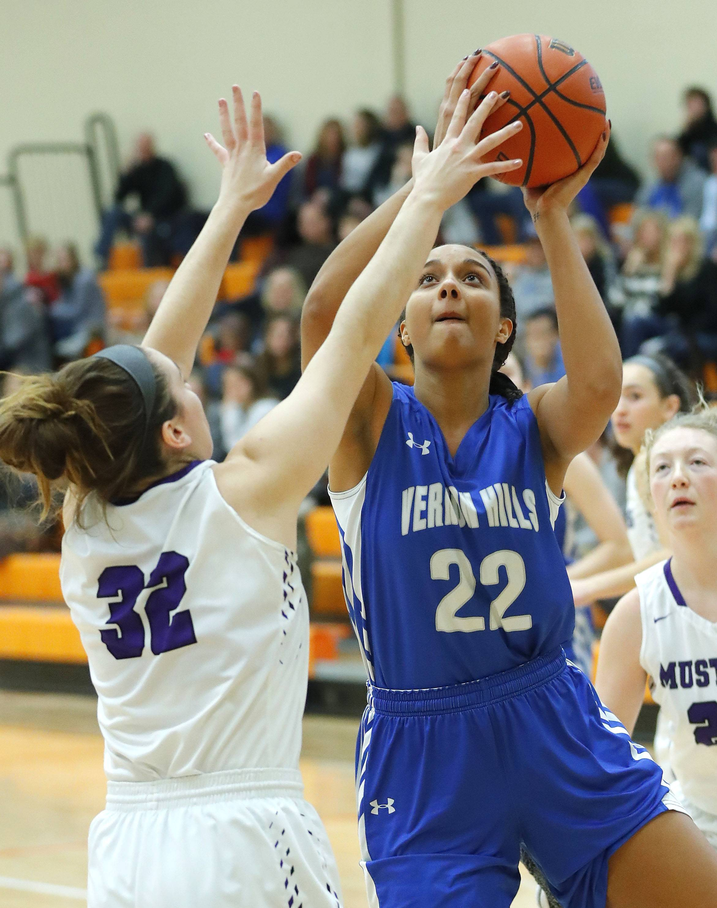 Vernon Hills' Kayla Caudle (22) drives on Rolling Meadows' Caili Hosler on Friday at Libertyville.