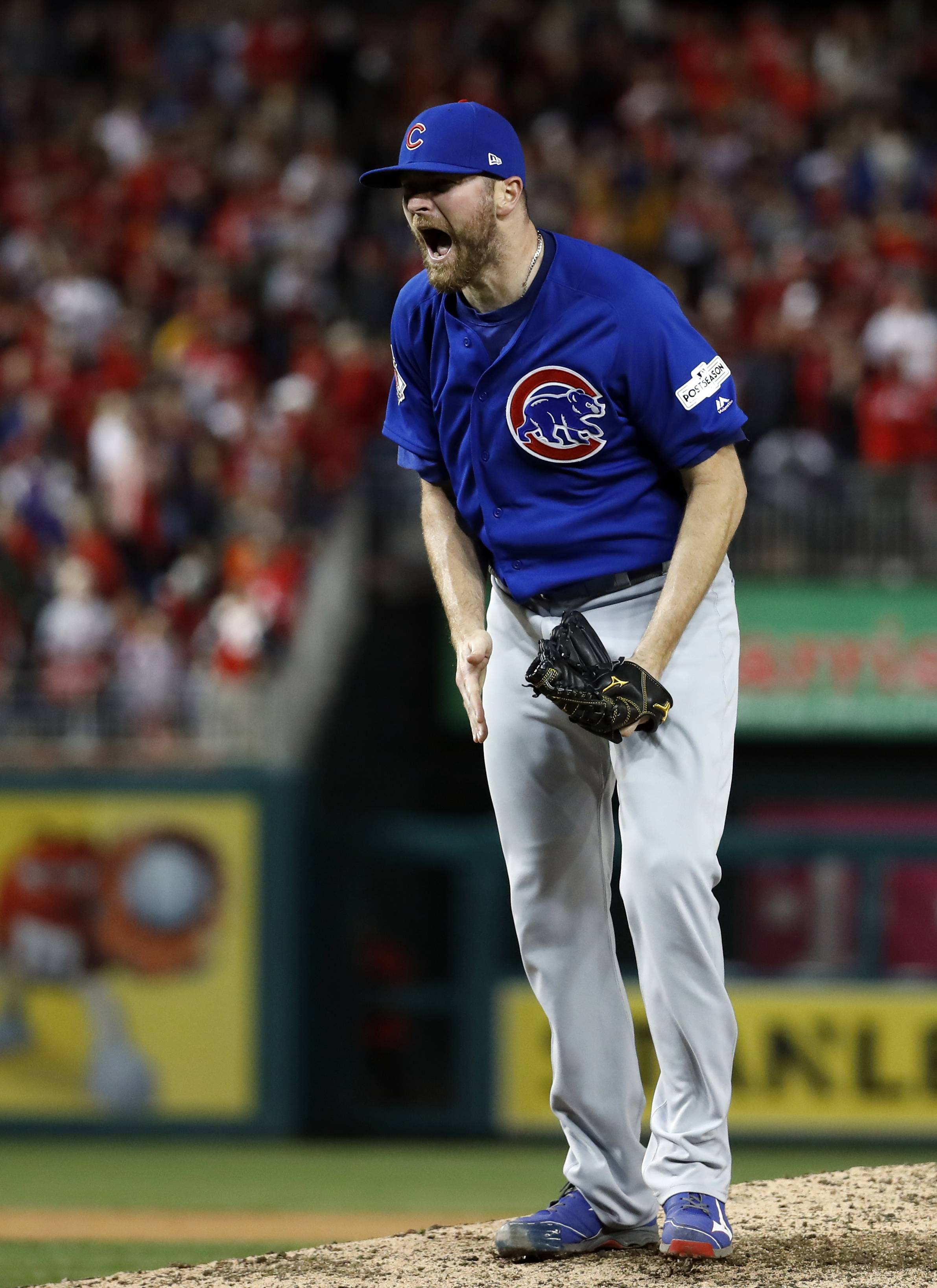 Chicago Cubs relief pitcher Wade Davis reacts after recording the final out against the Washington Nationals in Game 5 of the National League division series, in Washington.