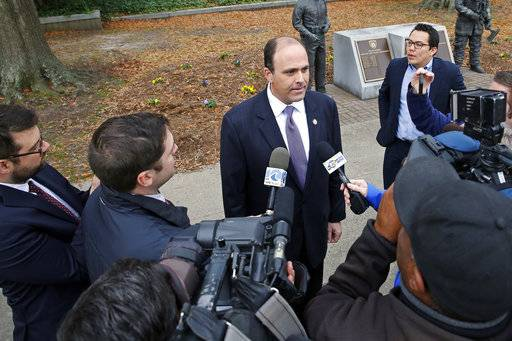 FILE- In this Dec. 20, 2017, file photo, Del. David Yancey talks with reporters outside the Newport News, Va., Courthouse. Shelly Simonds, the Democrat in a tied race for a Virginia House seat says she'll ask a court to declare the tie invalid. Simonds' lawyers said Tuesday, Dec. 26, that they'll ask the court to reconsider its ruling after last week's recount. Attorney Ezra Reese said the court violated election law by counting a ballot for Yancey a day after the recount. (Jonathon Gruenke/The Daily Press via AP, File)