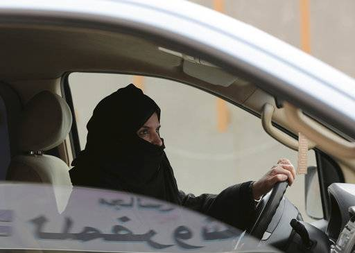 FILE - In this Saturday, March 29, 2014 file photo, Aziza Yousef drives a car on a highway in Riyadh, Saudi Arabia, as part of a campaign to defy Saudi Arabia's ban on women driving. This past year, Saudi Arabia laid the groundwork for momentous change next year in the conservative kingdom, defying its own reputation for slow-paced, cautious reforms. (AP Photo/Hasan Jamali, File)