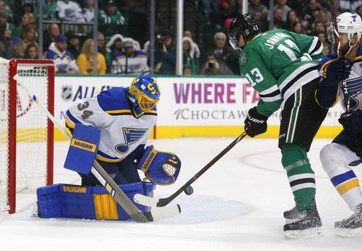 St. Louis Blues goaltender Jake Allen (34) makes a save on a shot by Dallas Stars center Mattias Janmark (13) during the first period of an NHL hockey game in Dallas, Friday, Dec. 29, 2017. (AP Photo/Michael Ainsworth)