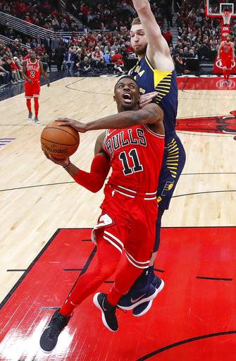 Chicago Bulls guard David Nwaba, front, goes to the basket against Indiana Pacers center Domantas Sabonis, back, during the first half of an NBA basketball game, Friday, Dec. 29, 2017, in Chicago.