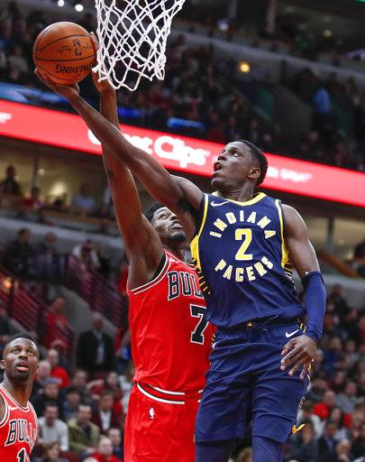 Indiana Pacers guard Darren Collison (2) goes to the basket against Chicago Bulls guard Justin Holiday (7) during the first half of an NBA basketball game, Friday, Dec. 29, 2017, in Chicago.