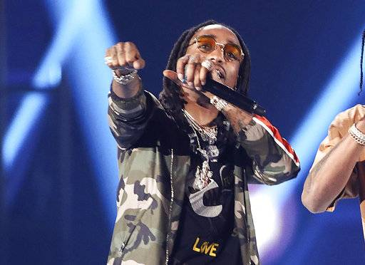 FILE - In this Saturday, Sept. 23, 2017, file photo, Quavo performs with Travis Scott and DJ Khaled at the 2017 iHeartRadio Music Festival Day 2 held at T-Mobile Arena on in Las Vegas. Quavo of the Grammy-nominated rap group Migos had some fun on social media after it was pointed out that he once held a high school football record that Houston Texans backup quarterback Taylor Heinicke eventually outdid. (Photo by John Salangsang/Invision/AP, File)