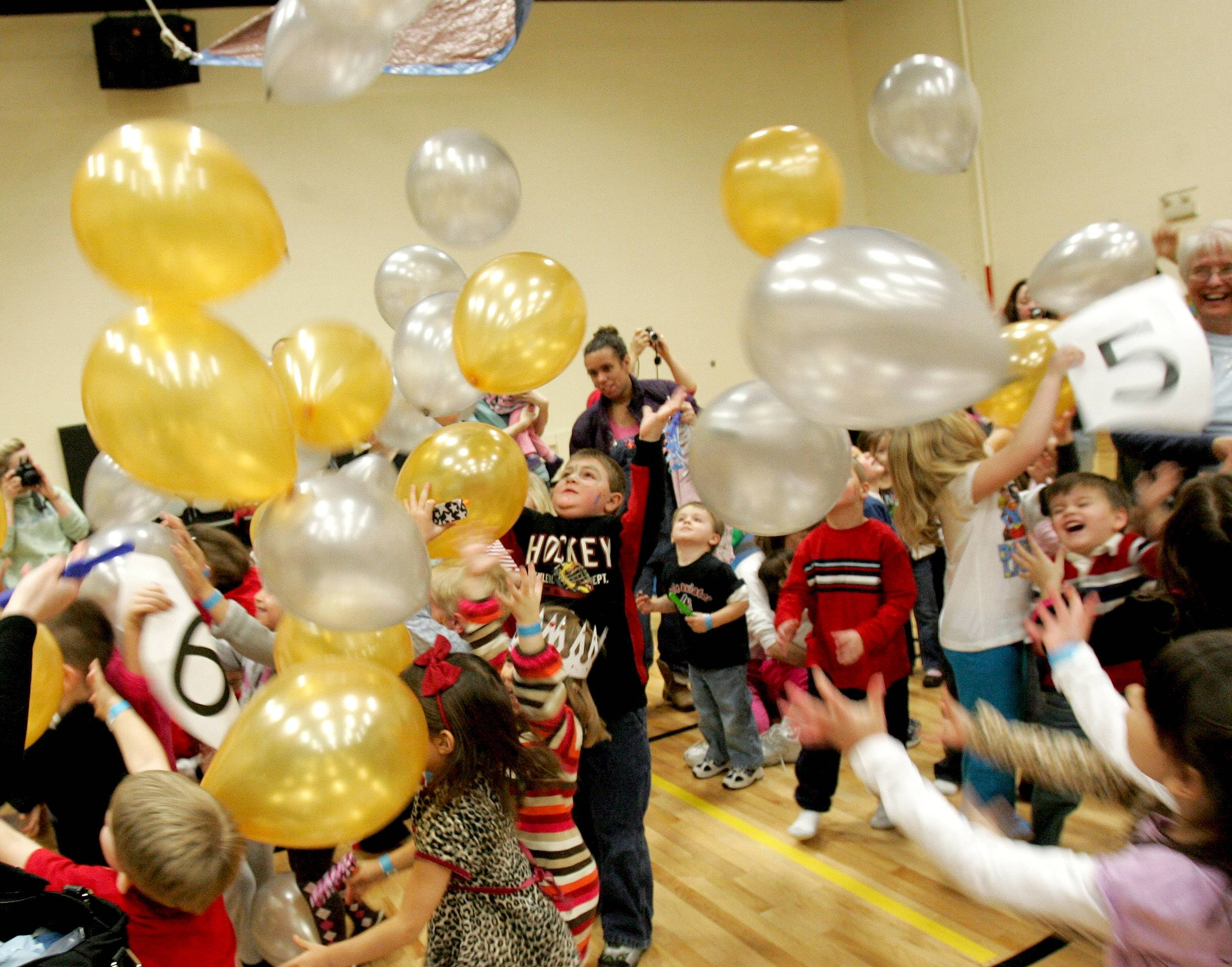 Young kids and their parents celebrate the New Year early at a previous Teenie Weenie New Year's Eve Ball at the Carol Stream Park District's Simkus Recreation Center.