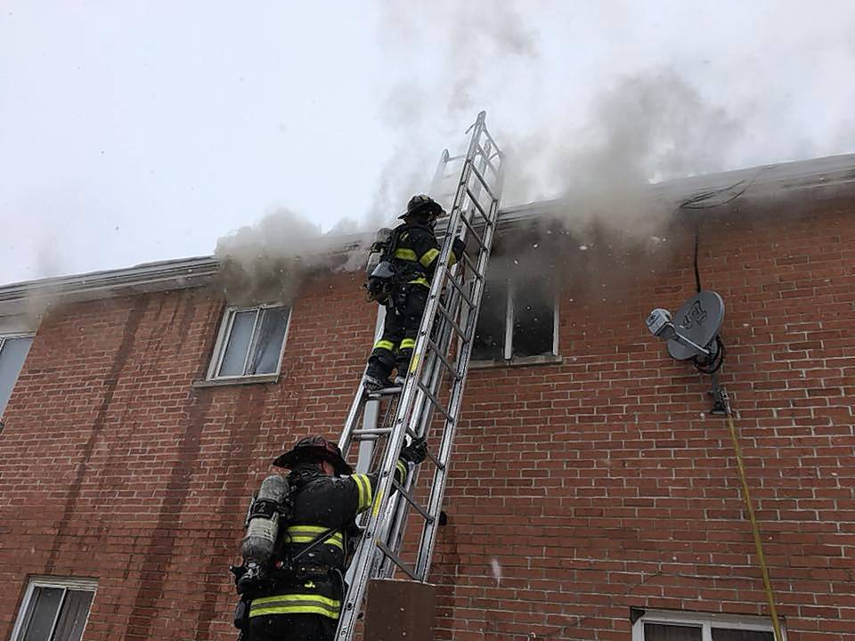Firefighters battle a blaze Friday afternoon at a six-unit apartment building in 1300 block of Monomoy Street on the west side of Aurora.