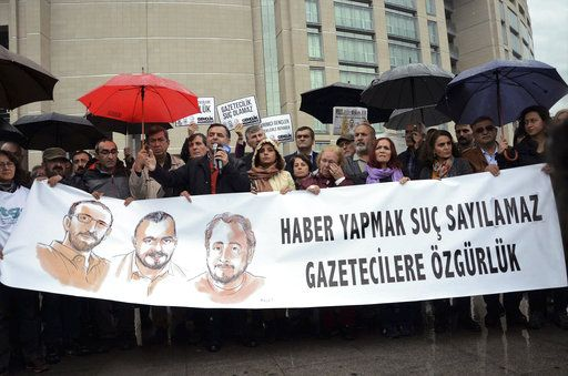"FILE - A Tuesday, Oct. 24, 2017 file photo showing journalists and human rights activists holding a banner that reads "" Journalism is not a crime - free journalists "" outside the main courthouse in Istanbul. Turkey, where official pressure on the media has been ramped up since a failed coup attempt in July 2016, is becoming notorious for putting reporters behind bars. Some 160 journalists are jailed in Turkey - two-thirds of the global total - the report said."