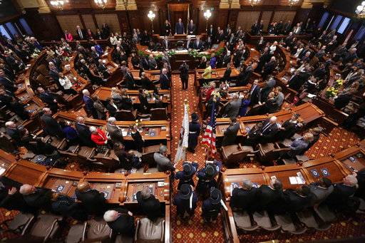 FILE - This Jan. 14, 2015 file photo shows the the Senate chamber at the State Capitol, in Springfield Ill. t was a big year in the Illinois statehouse with lawmakers ending an historic budget impasse and approving an income tax hike, overhauling how public schools get funding and allowing automatic voter registration. Now, a fresh set of 215 laws takes effect Jan. 1, 2018. The laws cover numerous topics, including the expansion of taxpayer-funded abortions, celebrating Barack Obama's presidency, allowing tax credits for private school scholarships, criminal justice reforms and a circus-related ban. (AP Photo/Seth Perlman File)