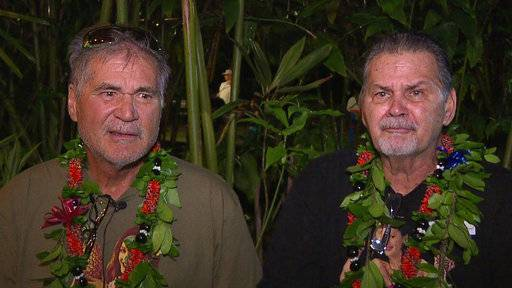 ADDS THAT ROBINSON IS AT LEFT - In this Dec. 23, 2017, image made from a video provided by Honolulu news station KHON, Alan Robinson, left, and Walter Macfarlane are interviewed in Honolulu. The two Hawaii men grew up as best friends and recently learned that they're actually brothers. They revealed the surprise to family and friends over the holidays. The two, who have been friends for 60 years, were born in Hawaii 15 months apart and met in the sixth grade. (KHON via AP)