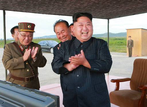 "FILE - In this undated file photo distributed on Sept. 16, 2017, by the North Korean government, North Korean leader Kim Jong Un, right, celebrates what was said to be the test launch of an intermediate range Hwasong-12 missile at an undisclosed location in North Korea. North Korea says it will never give up its nuclear weapons as long as the United States and its allies continue their ""blackmail and war drills� at its doorstep. Independent journalists were not given access to cover the event depicted in this image distributed by the North Korean government. The content of this image is as provided and cannot be independently verified. (Korean Central News Agency/Korea News Service via AP, File)"