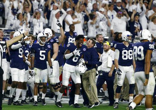 Penn State players celebrate during the final seconds of the second half of the Fiesta Bowl NCAA college football game against Washington, Saturday, Dec. 30, 2017, in Glendale, Ariz. (AP Photo/Ross D. Franklin)