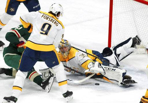 Minnesota Wild's Mikael Granlund (64), of Finland, is denied at the goal by Nashville Predators Pekka Rinne (35), of Finland, in front of Filip Forsberg (9), of Sweden, during the second period of an NHL hockey game on Friday, Dec. 29, 2017, in St. Paul, Minn. (AP Photo/Andy Clayton-King)