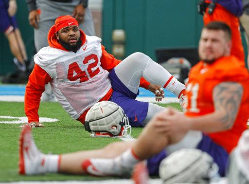 Clemson defensive lineman Christian Wilkins (42) stretches during practice for the upcoming Sugar Bowl semi-final playoff game against Alabama for the NCAA football national championship in New Orleans, Saturday, Dec. 30, 2017. (AP Photo/Gerald Herbert)