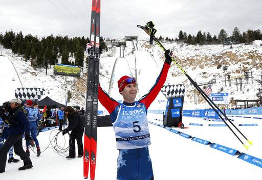 Bryan Fletcher celebrates after winning the cross-country ski portion of the Nordic Combined at the U.S. Olympic Team Trials, Saturday, Dec. 30, 2017, in Park City City. (AP Photo/Rick Bowmer)