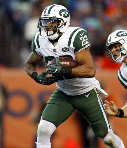 FILE - In this Dec. 10, 2017, file photo, New York Jets running back Matt Forte (22) runs against the Denver Broncos during the second half of an NFL football game in Denver. Forte says he has been playing on one leg since the team's bye week last month but has no intentions of calling it a career. (AP Photo/Joe Mahoney, File)