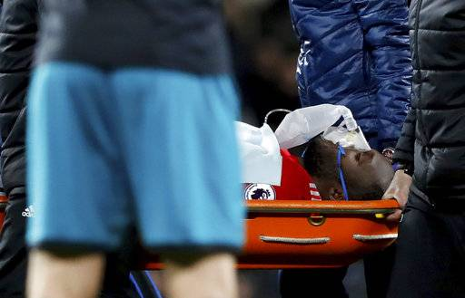 Manchester United's Romelu Lukaku is carried off on a stretcher after suffering a head injury during the English Premier League soccer match Manchester United versus Southampton at Old Trafford, Manchester, England, Saturday Dec. 30, 2017. (Martin Rickett/PA via AP)