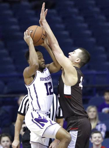 Northwestern guard Isiah Brown, left, drives to the basket as Brown forward Matt DeWolf guards during the first half of an NCAA college basketball game, Saturday, Dec. 30, 2017, in Rosemont, Ill. (AP Photo/Nam Y. Huh)