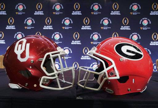 Helmets for Georgia and Oklahoma are displayed at a news conference in Los Angeles on Thursday, Dec. 28, 2017. Georgia will take on Oklahoma on Monday, Jan. 1, 2018. (AP Photo/Richard Vogel)