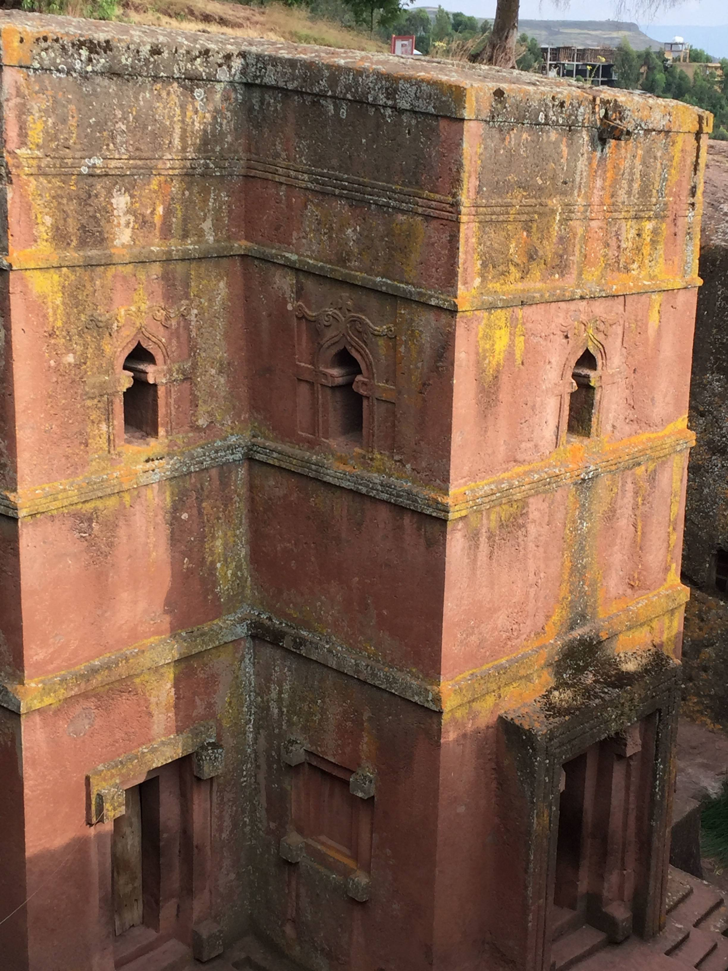 One of the 12th-century churches carved from stone in Lalibela, Ethiopia. The architectural marvels are one of the country's most magical attractions, miracles of engineering built 8,000 feet above sea level, each carved in one piece directly from soft volcanic rock.