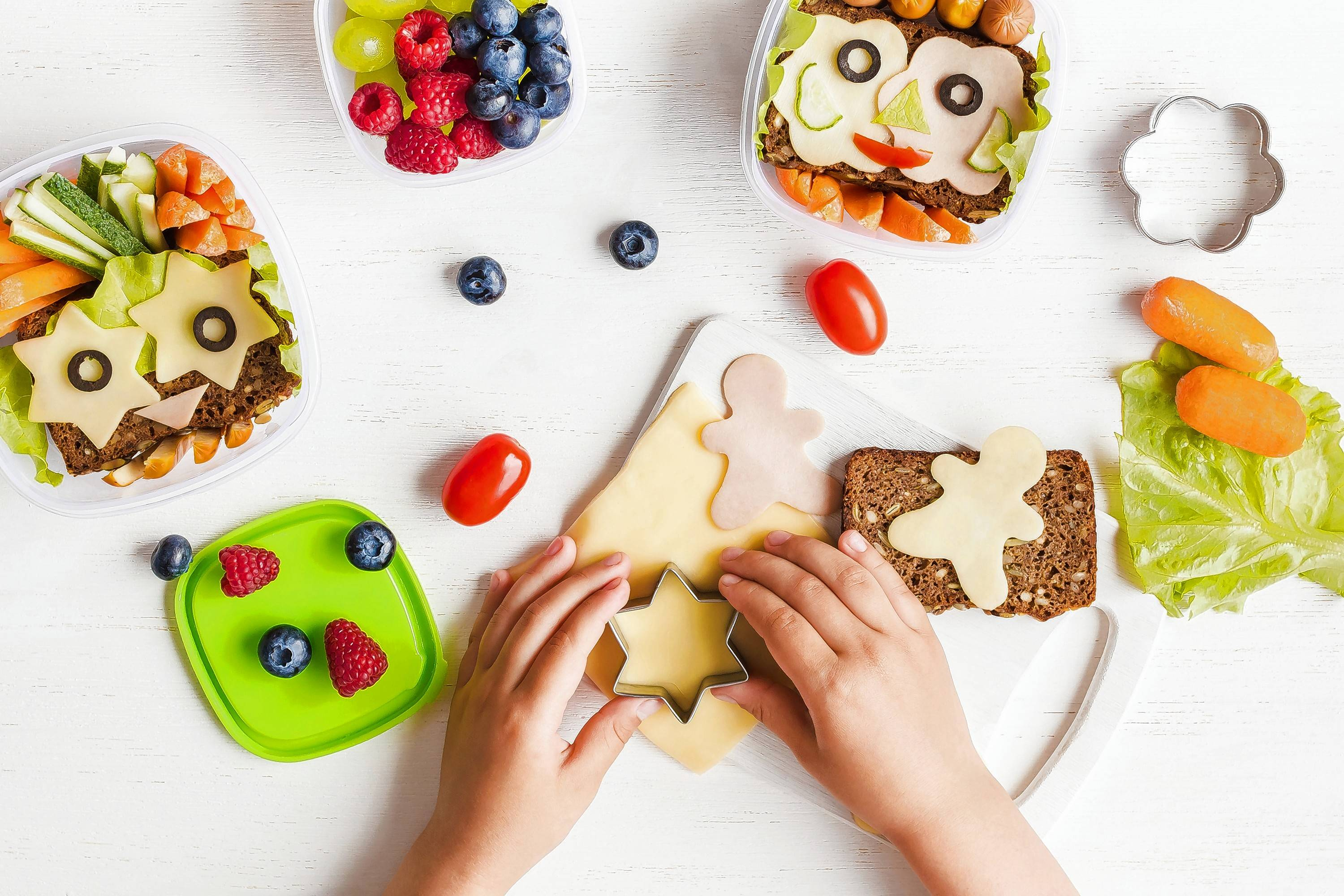 Cutting healthy food into fun shapes is one way to entice kids to eat their lunch.