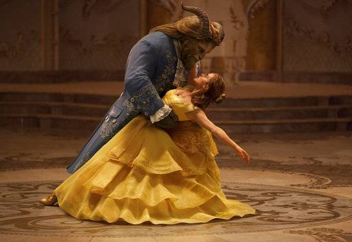 "FILE - This file image released by Disney shows Dan Stevens as The Beast, left, and Emma Watson as Belle in a live-action adaptation of the animated classic ""Beauty and the Beast."" On the last day of the calendar year, ""Star Wars: The Last Jedi� has surpassed ""Beauty and the Beast� as the top grossing film in North America in 2017.  (Disney via AP, File)"