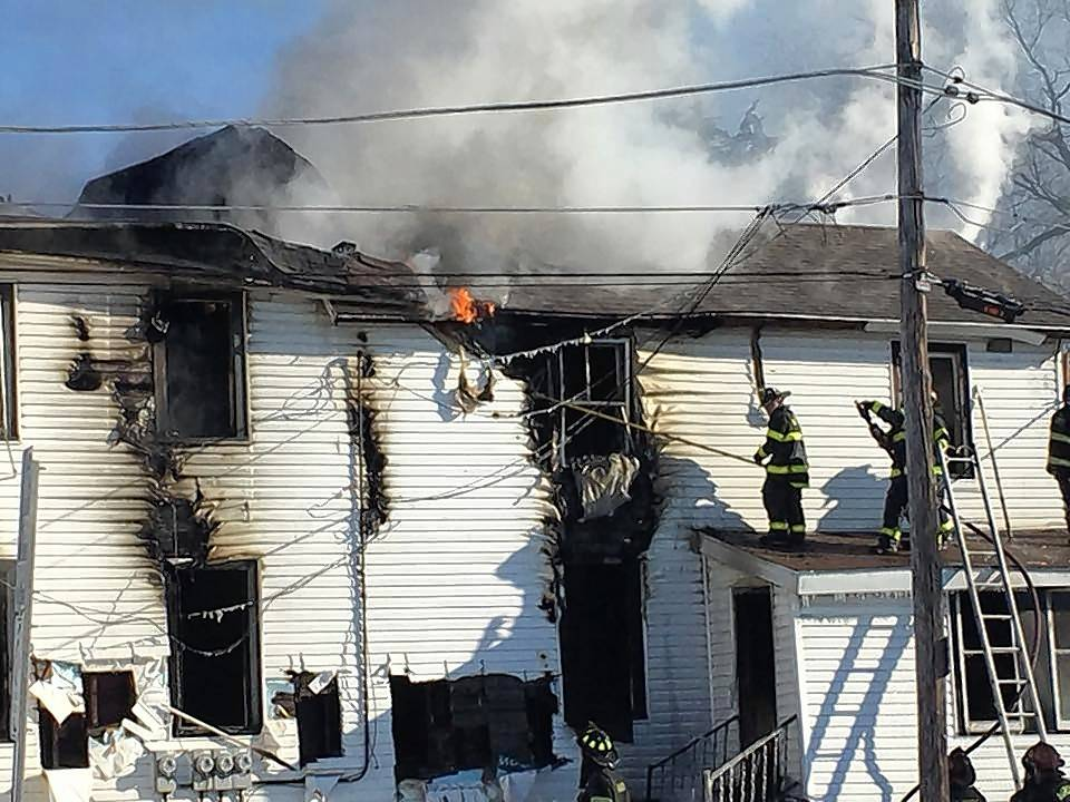 Aurora firefighters battle a blaze Sunday morning that gutted a home in the 400 block of Pierce Street. The fire began when a resident attempted to use a propane heater to thaw frozen pipes.