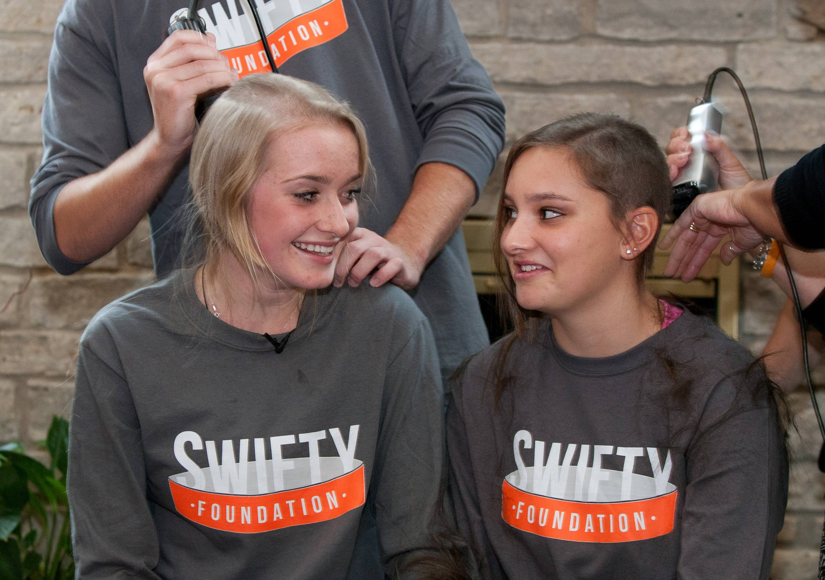 Kira Couch of Lisle, right, had her head shaved three years ago along with friend Bridget Gustafson of Woodridge, to raise money for the Swifty Foundation. The childhood cancer research organization was formed in honor of Gustafson's late twin, Michael, who died in 2013 at age 15.