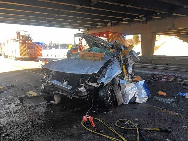 Firefighters from the Addison Fire Protection District extricated a man from this SUV Sunday morning after it drove off an Interstate 290 bridge and fell 10 to 15 feet to the southbound lanes of Route 83.