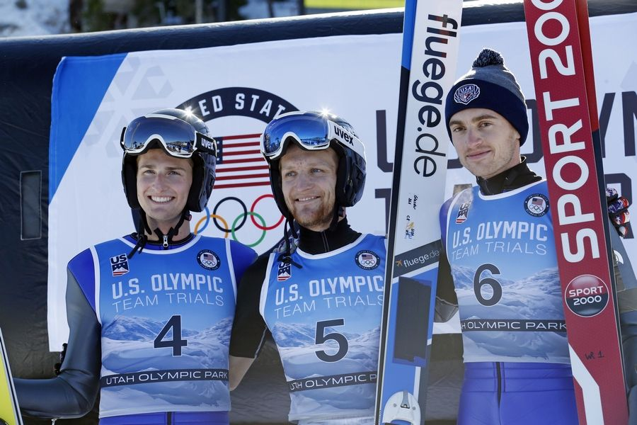 First place finisher Michael Glasder (5) shares the podium with second place finisher Kevin Bickner (4) and the third place finisher William Rhodes (6) following the men's ski jumping event at the U.S. Olympic Team Trials, Sunday, Dec. 31, 2017, in Park City, Utah. Glasder qualified for the Olympic team.
