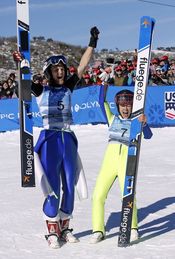 Michael Glasder (5) and Sarah Hendrickson (7) celebrate after winning in the ski jumping event at the U.S. Olympic Team Trials, Sunday, Dec. 31, 2017, in Park City, Utah. Glasder and Hendrickson both qualified for the Olympic team.