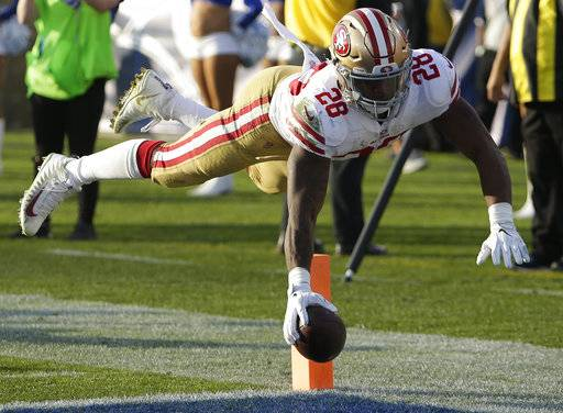 San Francisco 49ers running back Carlos Hyde scores against the Los Angeles Rams during the second half of an NFL football game Sunday, Dec. 31, 2017, in Los Angeles.