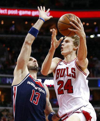 Washington Wizards center Marcin Gortat (13), from Poland, defends against Chicago Bulls forward Lauri Markkanen (24), from Finland, during the first half of an NBA basketball game, Sunday, Dec. 31, 2017, in Washington.