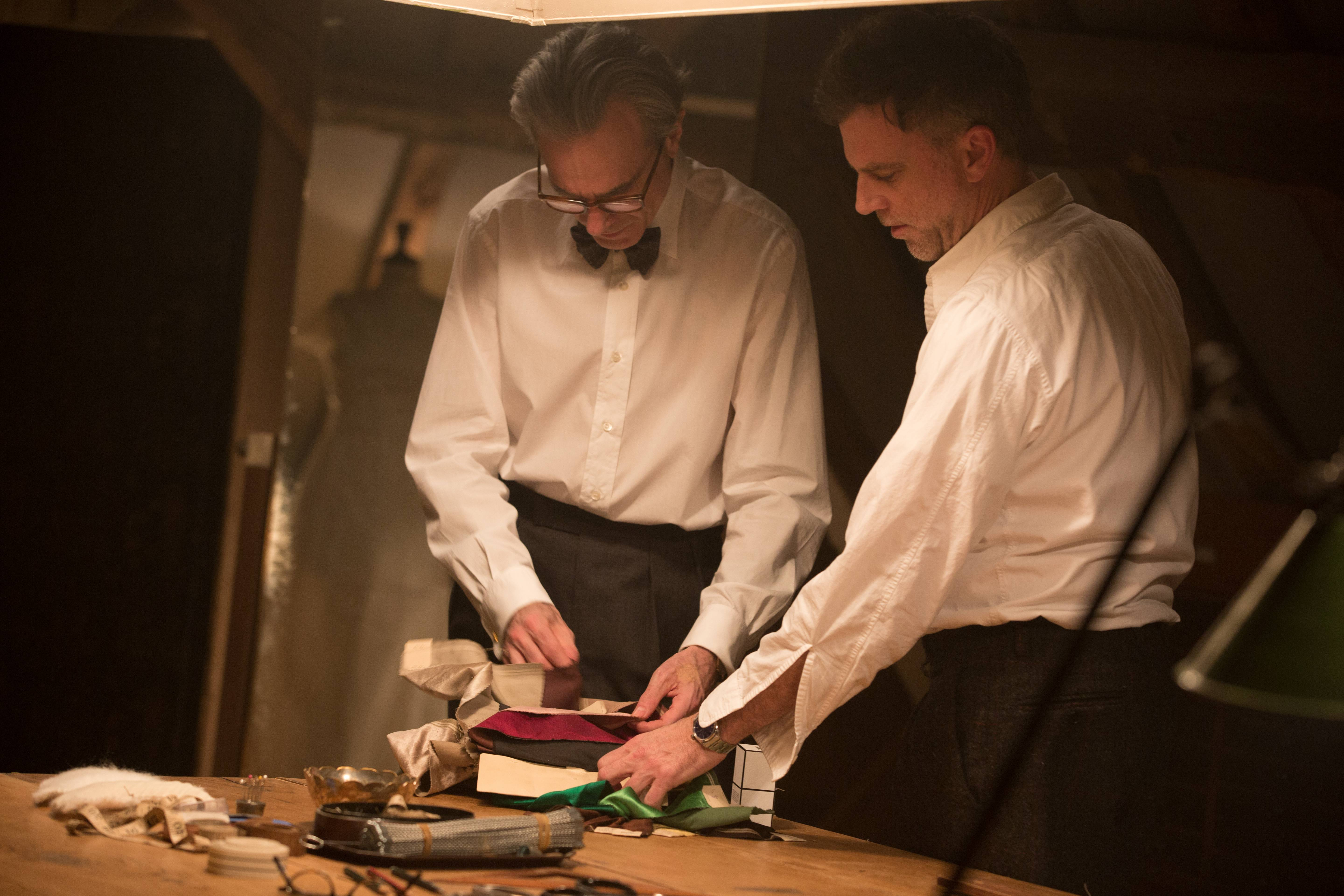 "Daniel Day-Lewis, left, works with director Paul Thomas Anderson on the set of ""Phantom Thread."" In ""Phantom Thread,"" Anderson stitches together a ""peculiar"" love story for what Daniel Day-Lewis has said will be his final film."