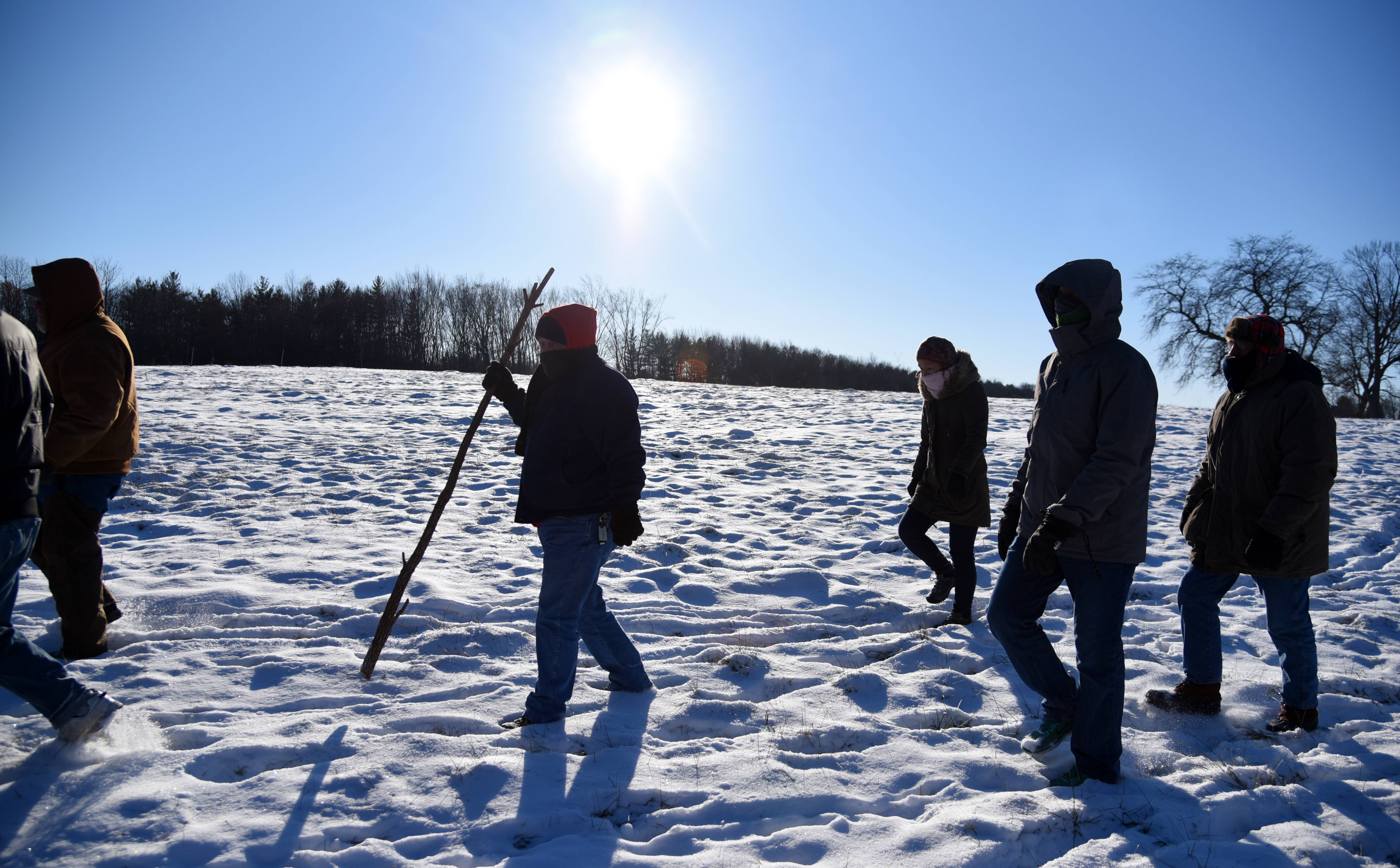 About a dozen hearty souls braved temperatures hovering around -10 Monday during a New Year's Day hike at the LeRoy Oakes Forest Preserve in St. Charles.