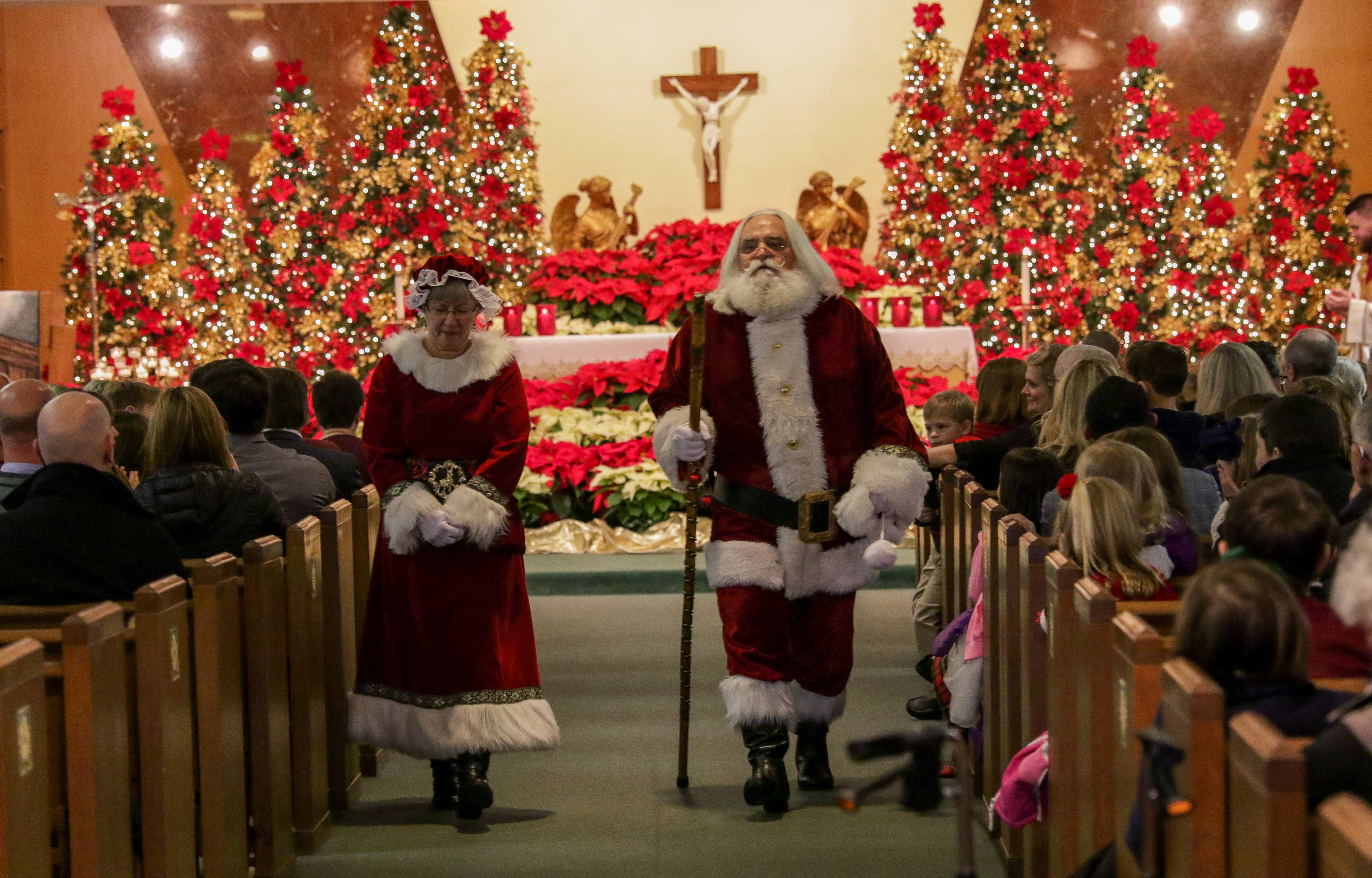 Bob and Carol Hildreth, of Elgin are Santa Claus ands Mrs. Claus during the Children's Christmas Mass at Immaculate Conception Church in Elmhurst on Sunday.