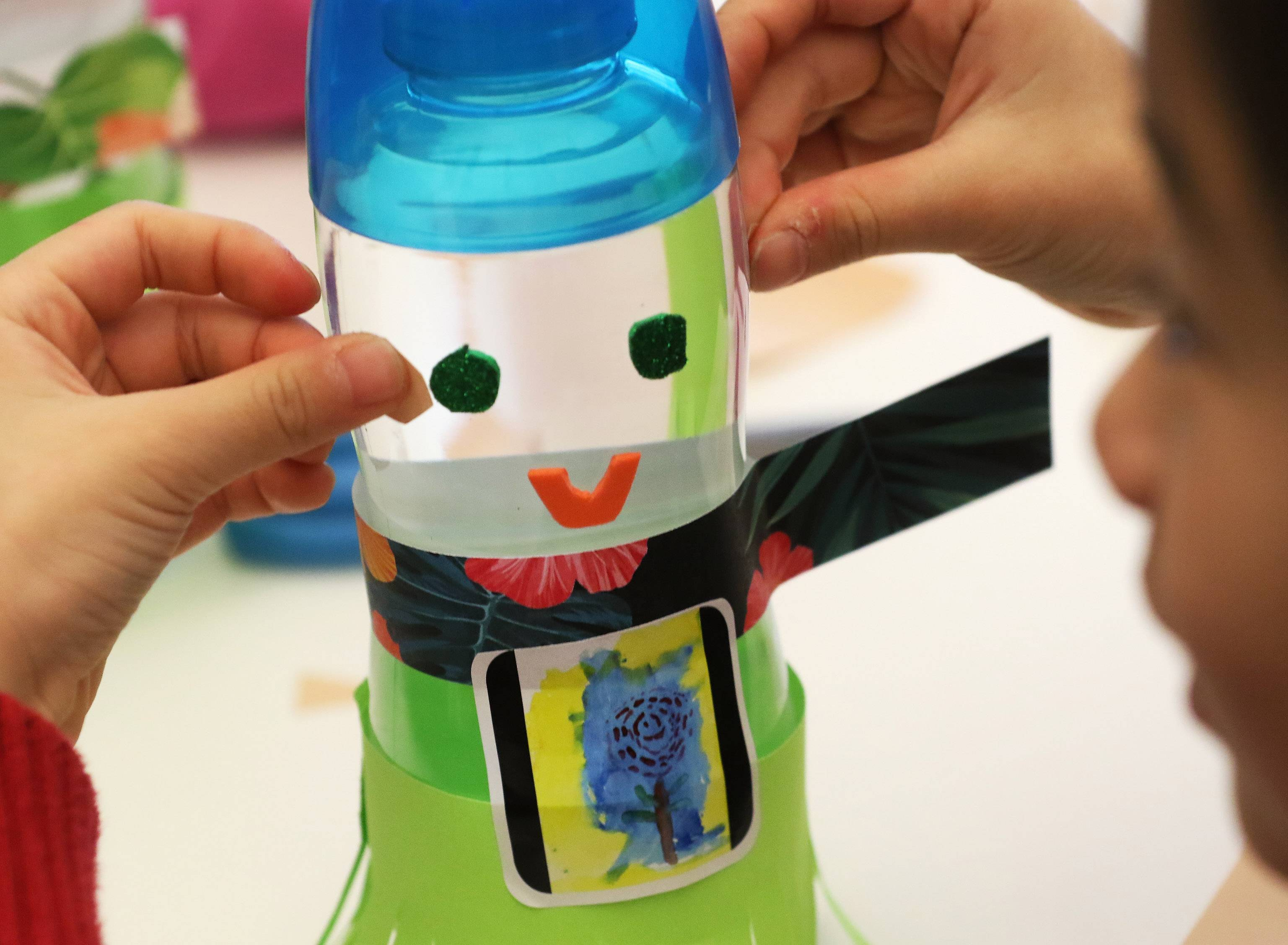 Children made snowman shakers during Make-And-Take Tropical Snowman on Wednesday at Vernon Area Public Library in Lincolnshire. Using plastic water battles, glitter and Hawaiian-themed paper, the children created the craft with their parents and caregivers.