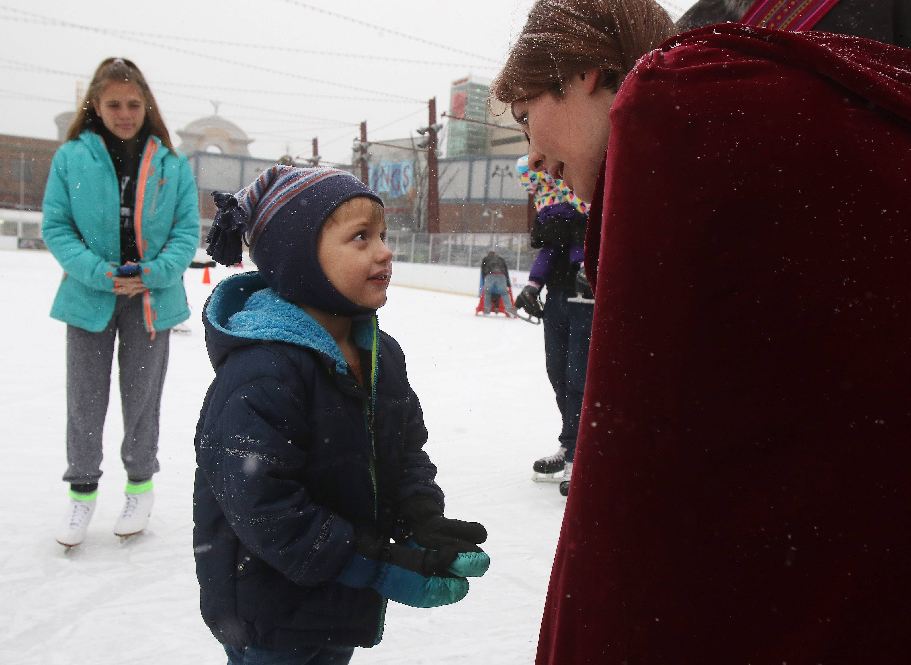 "Four-year-old Caydence Ziegenhorn, of Elmhurst talks with Anna, played by Jessica Dawson, during Sunday Funday Characters on Ice at the Chicago Wolves Ice Rink at MB Financial Park in Rosemont. Skaters enjoyed the lightly falling snow as they greeted Anna and Kristof from the Disney movie ""Frozen."""