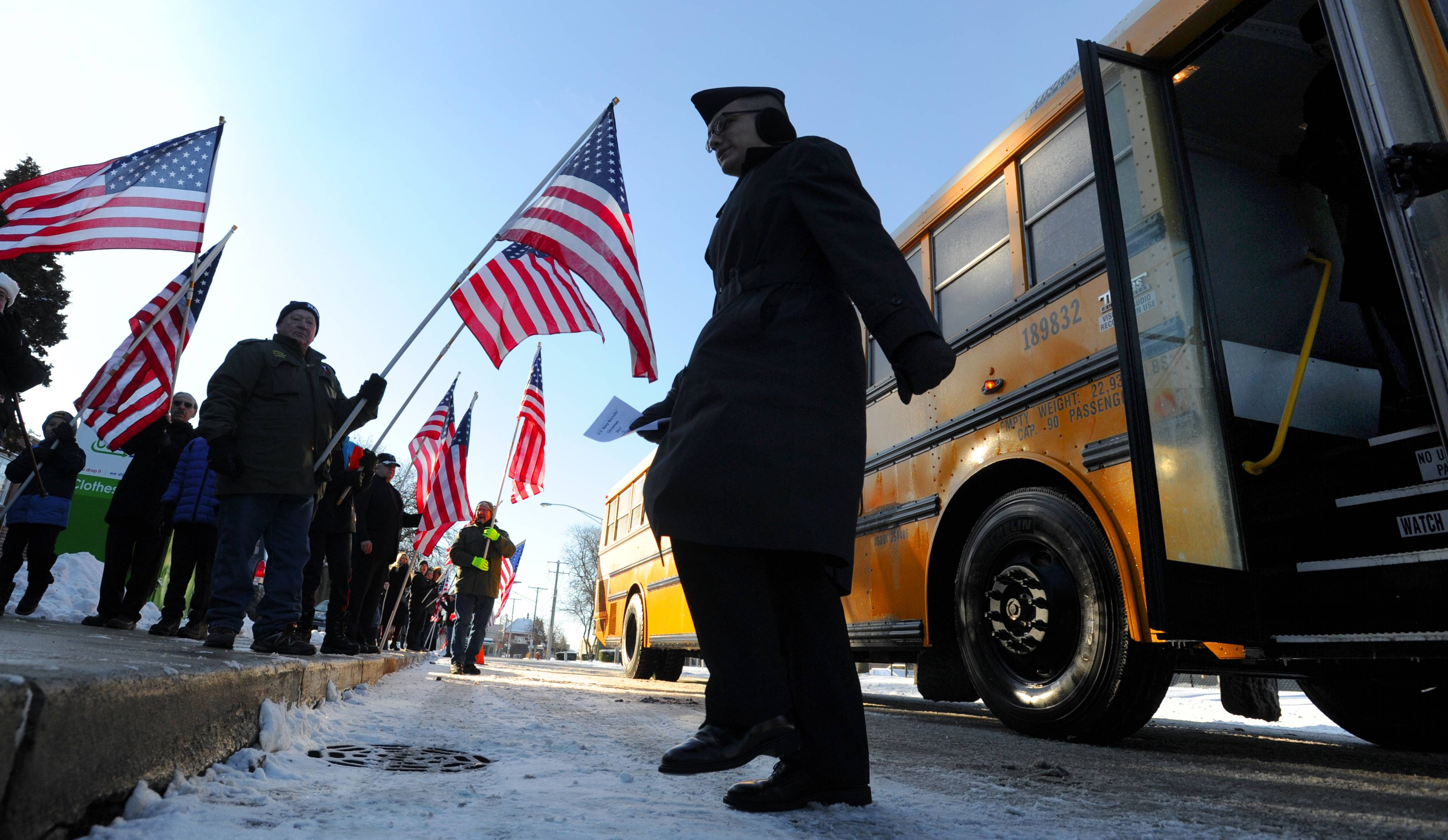 Sailors from Naval Station Great Lakes in North Chicago are welcomed to the U.S. Navy Recruits' Christmas party at Christian Liberty Academy on Christmas morning in Arlington Heights.