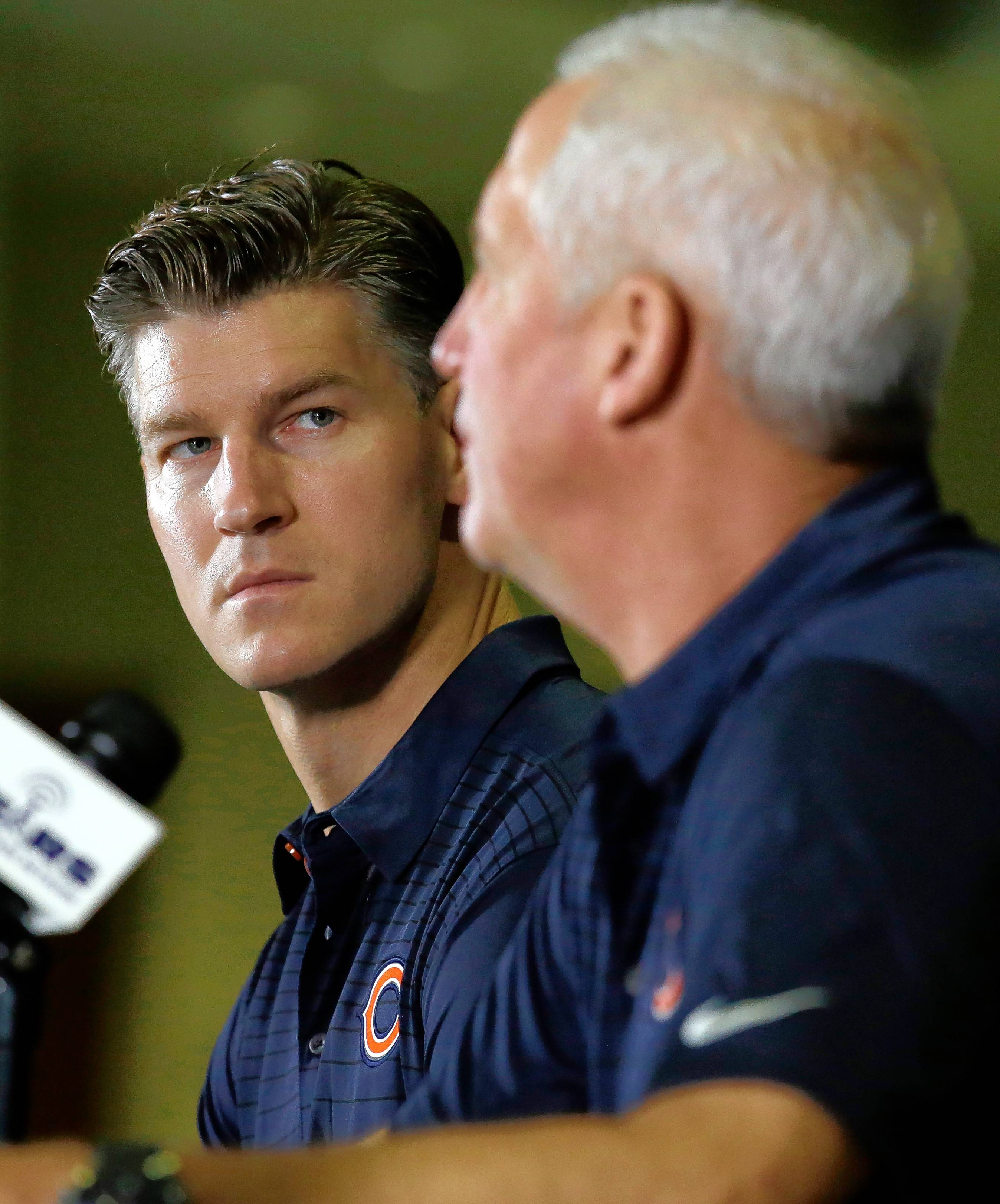 Chicago Bears general manager Ryan Pace, left, listens to head coach John Fox during an NFL football training camp in Bourbonnais, Ill., Wednesday, July 26, 2017. (AP Photo/Nam Y. Huh)