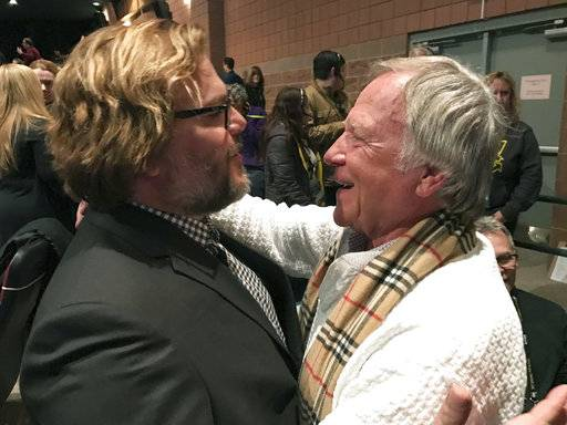 "In a Jan. 22, 2017 photo, Jan Lewandowski, right, better known as Jan Lewan, embraces actor and comedian Jack Black at the premiere of ""The Polka King� at the Sundance Film Festival in Park City, Utah. Lewandowski's rise and fall is the subject of ""The Polka King,� a comedy starring Black as the polka bandleader convicted of fleecing fans of millions of dollars. (John Koterba via AP)"