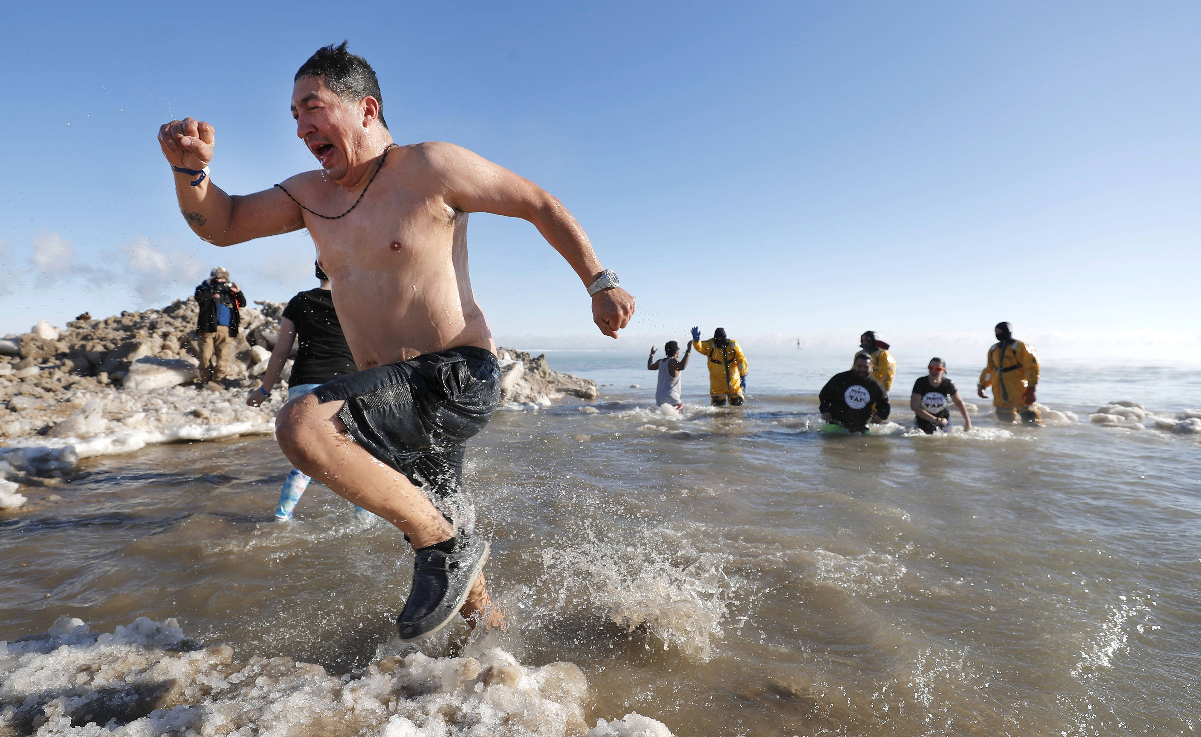 Hundreds of people took a frosty dip into Lake Michigan Monday and dashed out just as quickly. It was part of Waukegan's Polar Bear Plunge, which went on despite an air temperature of six below zero.