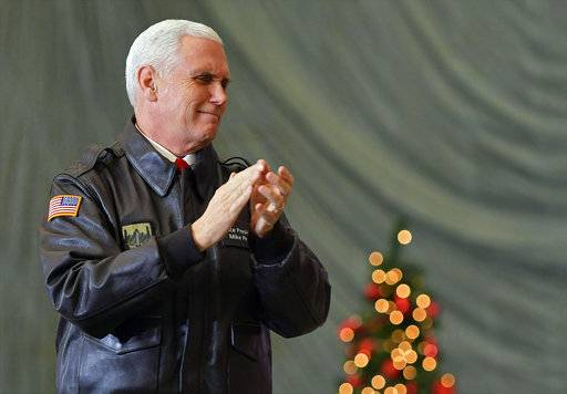 FILE - In this Thursday, Dec. 21, 2017 file photo, U.S. Vice President Mike Pence speaks to troops in a hangar at Bagram Air Base in Afghanistan. Israel's Foreign Ministry said Monday Jan. 1, 2018 that an expected visit by Pence has been postponed again. Pence was scheduled to visit Israel in December 2017. (Mandel Ngan/Pool via AP, File)